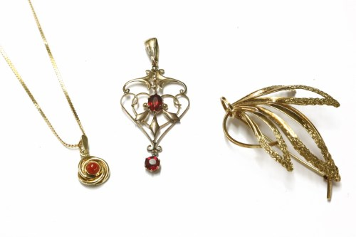 Lot 24-An Edwardian gold oval cut ruby doublet open work pendant