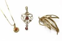 Lot 24-An Edwardian gold oval cut ruby doublet open work pendant