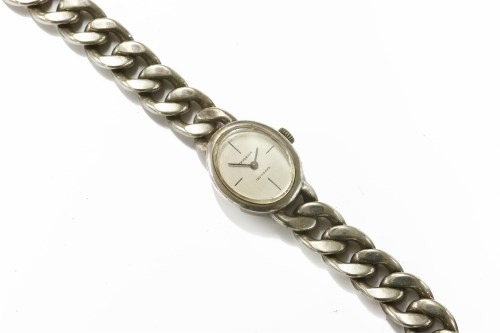 Lot 16-A ladies Continental silver Dugena mechanical bracelet watch with curb link braclet