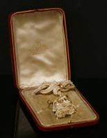Lot 1-A seed pearl matched brooch and earrings suite