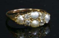 Lot 97 - A late Victorian split pearl and diamond boat-shaped ring