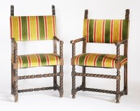 Lot 369-A pair of walnut elbow chairs