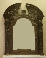 Lot 372-A large and ornate Victorian oak overmantel mirror