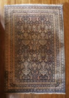 Lot 324-An Indo-Ziegler wool carpet