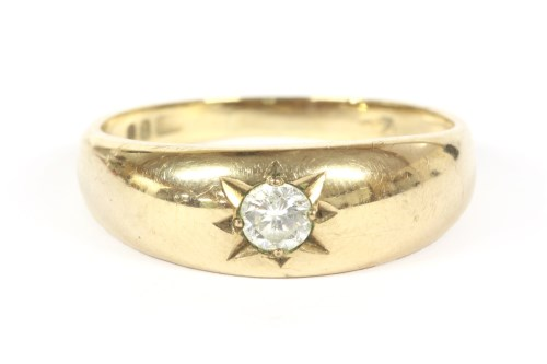 Lot 7-A gentleman's 9ct gold single stone brilliant cut diamond ring