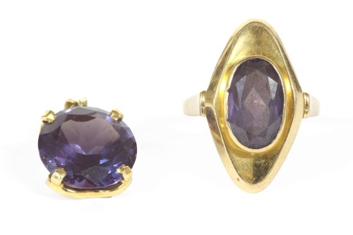 Lot 4-A gold single stone oval mixed cut synthetic colour change sapphire ring