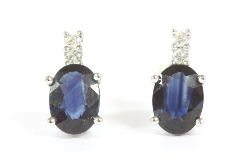 Lot 8-A pair of white gold sapphire and diamond stud earrings