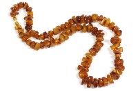 Lot 47-A single row graduated free-form amber necklace