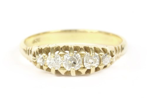 Lot 14-A gold graduated five stone diamond ring