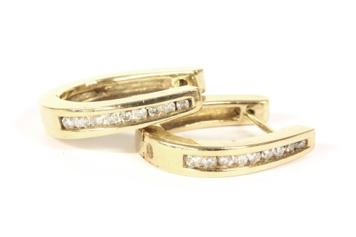 Lot 21-A pair of 9ct gold channel set brilliant cut diamond hinged earrings 4.60g