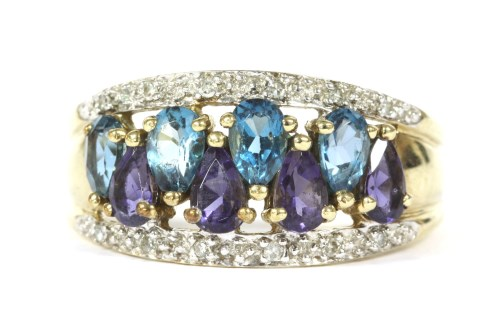 Lot 6-A gold four row pear cut purple and blue stone and diamond ring