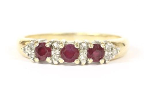 Lot 17-A 9ct gold circular mixed cut ruby and diamond half hoop ring