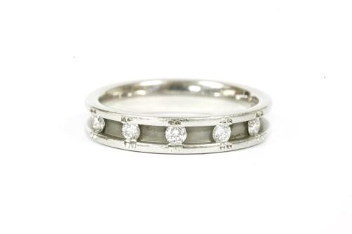 Lot 13-A platinum five stone diamond half eternity ring