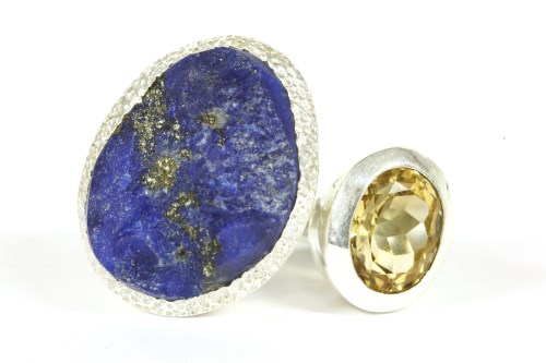 Lot 12-A silver un-cut free form lapis lazuli ring and oval cut citrine ring 17.65g