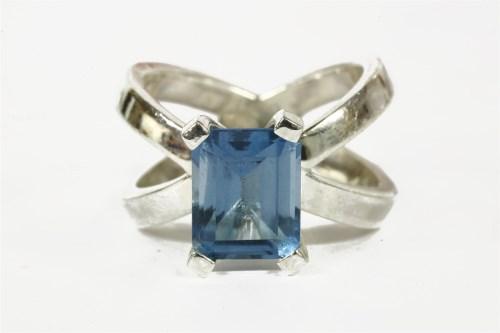 Lot 5-A silver single stone emerald cut blue topaz ring