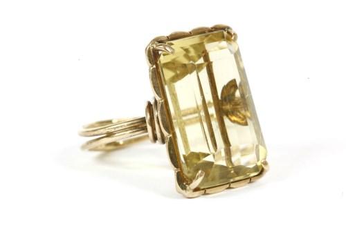 Lot 24-A gold emerald cut citrine ring