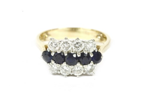 Lot 11-An 18ct gold three row sapphire and diamond ring