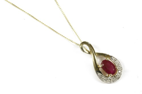 Lot 10-A gold ruby and diamond pendant