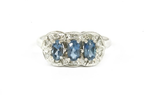 Lot 22-A 9ct white gold three stone blue topaz and diamond cluster ring