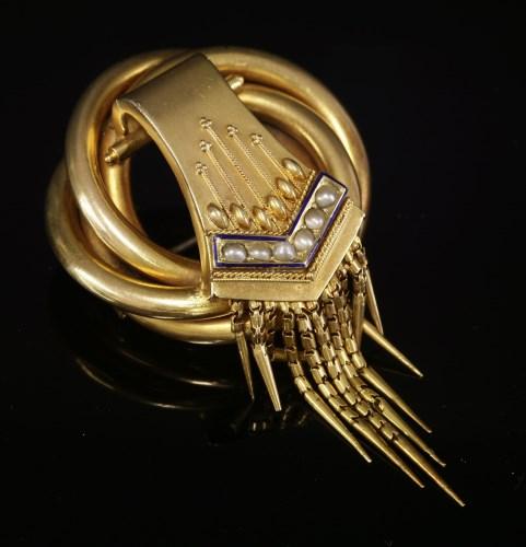 Lot 35-A Victorian gold split pearl knot brooch