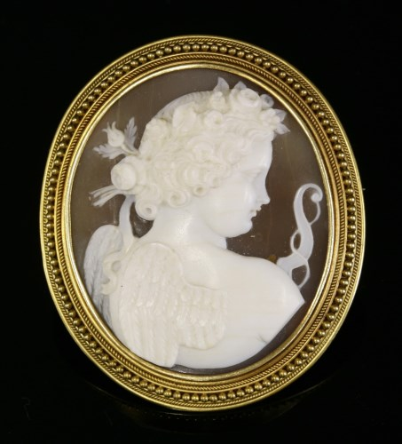 Lot 40-A Victorian carved shell cameo brooch depicting Cupid