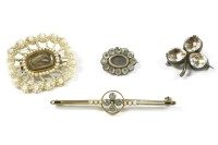 Lot 35-An Edwardian gold quatrefoil aquamarine and split pearl bar brooch