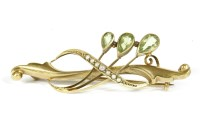 Lot 36-An Edwardian 9ct gold pear shaped peridot and split pearl bar brooch  2.85g