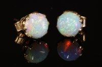 Lot 71-A pair of single stone opal stud earrings