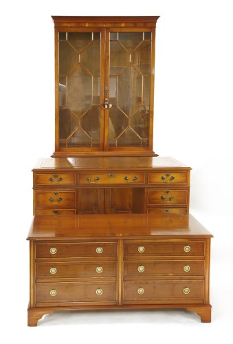 Lot 665 - A Bradley furniture Georgian style yew wood office suite