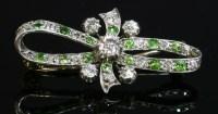 Lot 80 - A Victorian diamond and demantoid garnet bow brooch