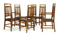 Lot 16-A set of six Arts and Crafts oak dining chairs