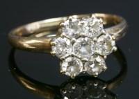 Lot 77 - An Edwardian diamond cluster ring