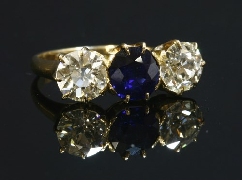 92 - A three stone sapphire and diamond ring