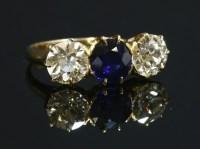 Lot 92 - A three stone sapphire and diamond ring