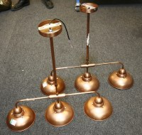 Lot 657-A pair of copper effect three branch electrical lights by Däär