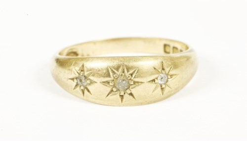 Lot 18-An 18ct gold three stone diamond star set gypsy ring 4.61g