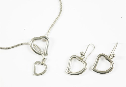 Lot 15-A silver Yves Saint Laurent heart pendant necklace on a rat tail link chain
