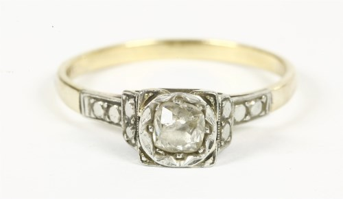 Lot 11-A gold single stone illusion set cushion cut diamond ring