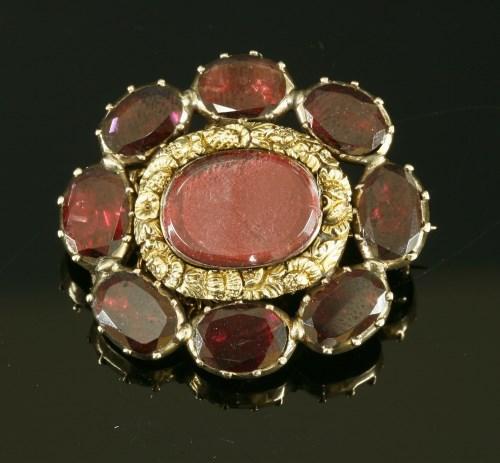 Lot 3-A garnet set gold memorial brooch