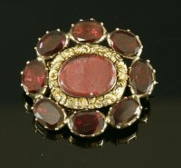 Lot 3-A garnet set gold memorial brooch