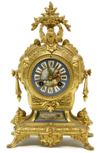 Lot 628-A French gilt metal mantel clock