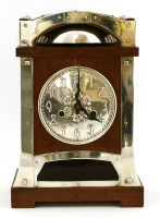 Lot 11-A Continental oak and silver-plated mantel clock
