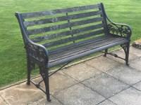 Lot 12-A cast iron garden bench