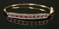 Lot 98 - A Continental silver and gold ruby bangle