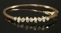 Lot 85 - A Continental diamond set oval hinged bangle