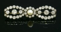 Lot 82 - A late Victorian cultured pearl and diamond cluster bar brooch