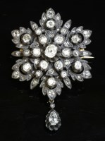 Lot 73-A Victorian diamond set star or flower head cluster brooch/pendant