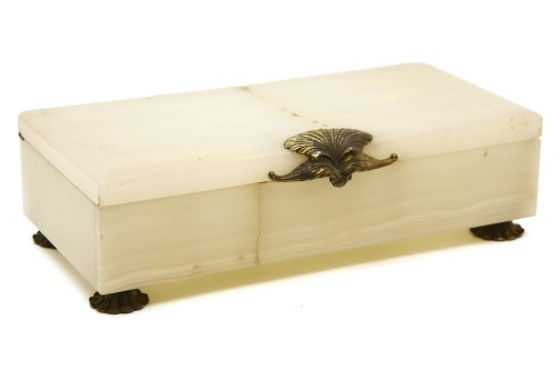 Lot 627-An onyx and silver gilt mounted cigarette box