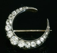 Lot 83 - A late Victorian diamond set crescent brooch or fourcher