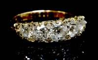 Lot 68-A graduated five stone diamond carved head ring